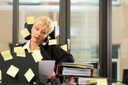 Business Woman Trapped by Sticky Notes